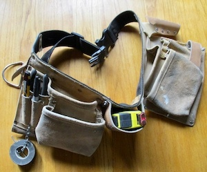 Photo of a tool belt with tools.